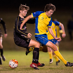 BRISBANE, AUSTRALIA - AUGUST 26: Jeremy Stewart of the Strikers is fouled by Rhys Gwynn-Jones of Moreton Bay during the NPL Queensland Senior Men's Semi Final match between Brisbane Strikers and Moreton Bay Jets at Perry Park on August 26, 2017 in Brisbane, Australia. (Photo by Patrick Kearney)
