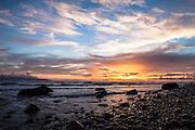 Colorful, scenic sunset at Homer Beach. Homer, Alaska.