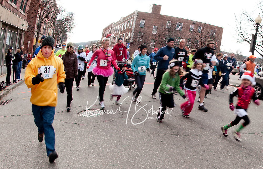 Alex Van Leuven along with over 150 runners/walkers start off from MC Cycle on Main Street for the Frozen 5K to benefit WLNH Children's Auction on Saturday morning.  (Karen Bobotas/for the Laconia Daily Sun)