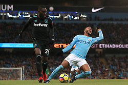 Manchester City's Raheem Sterling (right) goes down in the penalty area after a challenge by West Ham United's Arthur Masuaku but no penalty is awarded