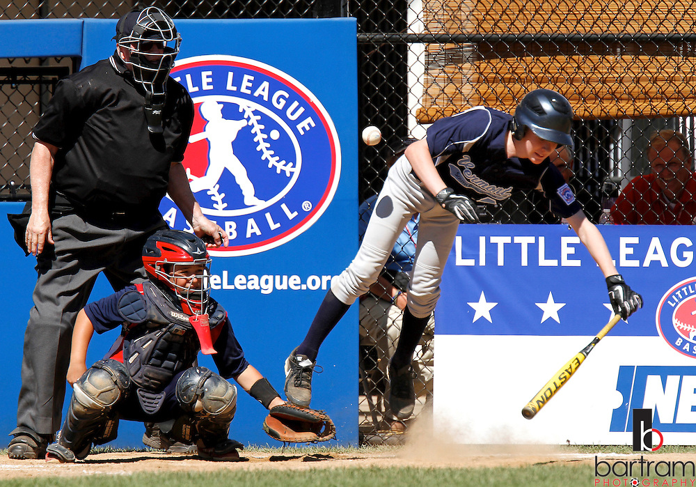 South Burlington's Nicholas Liscinsky is hit by a pitch during a New England Regional Little League game between South Burlington from Vermont and Lincoln from Rhode Island in Bristol, CT. (Photo by Kevin Bartram)