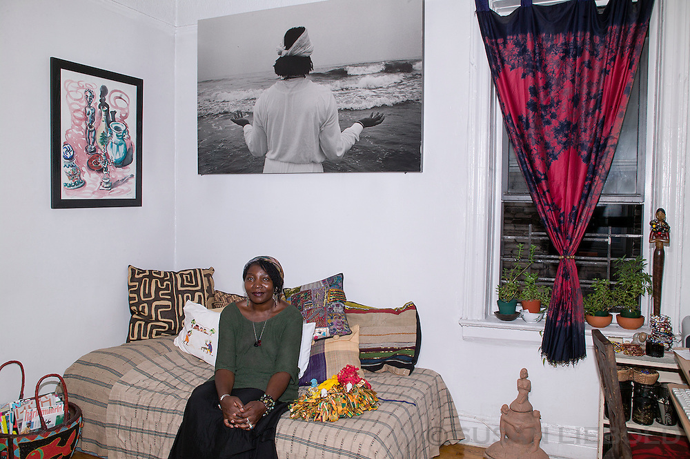 Vicki, an artist from Cameroon, in her home in Harlem.