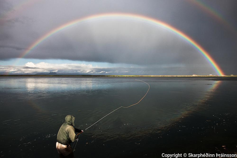 Casting under the rainbow. Salmon fishing in West Rangá/Hólsá, south Iceland