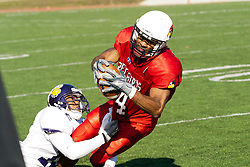 29 October 2005: Redbird Pierre Jackson holds on while being brought to the ground by Leatherneck William Penn. With a final score of 31 - 17, Western Illinois University Leathernecks collared the Illinois State University Redbirds knocking them from their 18th ranked perch at Hancock Field on Illinois State's campus in Normal IL