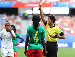 Cameroon's Yvonne Leuko (centre) is shown a yellow card by referee Qin Liang (right) on a foul on England's Nikita Parris during the FIFA Women's World Cup, round of Sixteen match at State du Hainaut, Valenciennes.