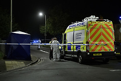 © Licensed to London News Pictures. 08/10/2021. Oxford, UK. A Thames Valley Police van parked alongside forensic investigators at the scene in Bayswater Road, Barton in Oxfordshire. Police were called just before 6:00pm today, Friday 08/10/2021, to reports of a man being stabbed, the victim, a man aged in his thirties, died of his injuries at the scene. Photo credit: Peter Manning/LNP