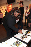 25 August New York, NY-  Actress Gabourey Sidibe signs posters at the Imagenation Cinema Foundation Screening of ' Yelling to the Sky ' presented by the Imagenation Cinema Foundation and The Film Society of Lincoln Center held at the Walter Reade Theater at Lincoln Center on August 25, 2011 in New York, NY. Photo Credit: Terrence Jennings