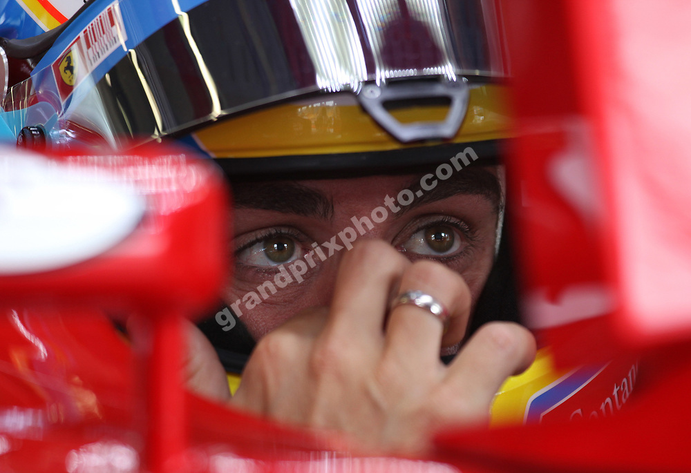 Fernando Alonso (Ferrari) in the pits with his helmet on during practice for the 2010 Turkish Grand Prix in Istanbul Park. Photo: Grand Prix Photo