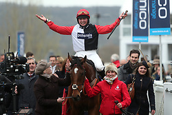 Jockey Miss Bryony Frost celebrates after her winning ride on Pacha Du Polder in the St. James's Place Foxhunter Challenge Cup Open Hunters' Chase during Gold Cup Day of the 2017 Cheltenham Festival at Cheltenham Racecourse.