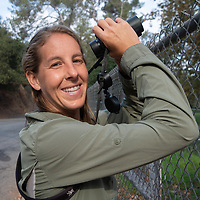 Biologist Courtney McCammon studies an owl's nest in Griffith Park, Los Angeles, California.