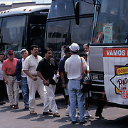"""TIJUANA, MEXICO:  Baseball fans line up to get on a bus that will take them to a San Diego Padres game in San Diego, California. The """"Domingos Con Padres"""" programs was designed to reach out the the Padres fan base across the border and offered discounted tickets, transportation and expedited entry through Customs."""