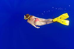 woman snorkeler in blue water, off Kona Coast, Big Island, Hawaii, Pacific Ocean
