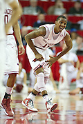 Feb 16, 2013; Fayetteville, AR, USA; Arkansas Razorbacks guard BJ Young (11) reacts to an injury during a game against the Missouri Tigers at Bud Walton Arena. Arkansas defeated Missouri 73-71. Mandatory Credit: Beth Hall-USA TODAY Sports