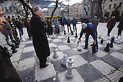 A human scale chess match on a cold winter's day in a downtown Sarajevo park, Bosnia and Herzegovina. ©2005 Hungry Planet: What the World Eats