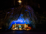 A life-size Nativity scene in the replica of the Lourdes Grotto at the Way of Lights holiday light display at the National Shrine of Our Lady of the Snows in Belleville on December 3, 2019. This is the 50th anniversary of the annual light display, which runs from 5 pm to 9 pm through December 31. There are also indoor activities including a Christmas tree room, decorated wreaths, and children's craft activities. Carriage rides are available at the Way of Lights.<br />Photo by Tim Vizer