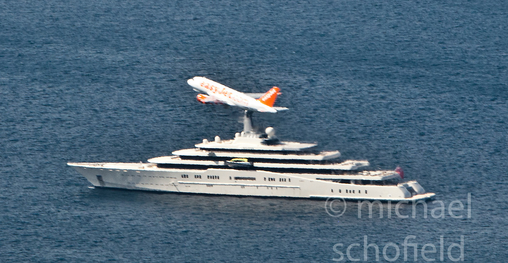 An EasyJet plane flies over the Russian businessman Roman Abramovich yacht, the M/Y Eclipse in the harbour of the Strait of Gibraltar. Photographs from the top of the Rock of Gibraltar. Images of Gibraltar, the British overseas territory located on the southern end of the Iberian Peninsula at the entrance of the Mediterranean.