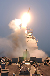© Licensed to London News Pictures. 29/08/2013. File pic. The first Tomahawk missile to be fired into Iraq is launched from USS BUNKER HILL (CG 52) at 0525 on March 20, 2003.  HILL was forward deployed to the Persian Gulf in support of operations against Iraq.  The USA and UK are currently considering military action in Syria following reports of chemical weapons being used on civilians. Photo credit U.S. Navy/LNP