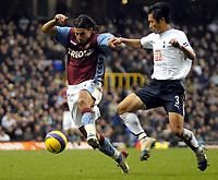 Photo: Ed Godden.<br /> Tottenham Hotspur v Aston Villa. The Barclays Premiership. 26/12/2006. Villa's Milan Baros (L), is challenged by Young-Pyo Lee.