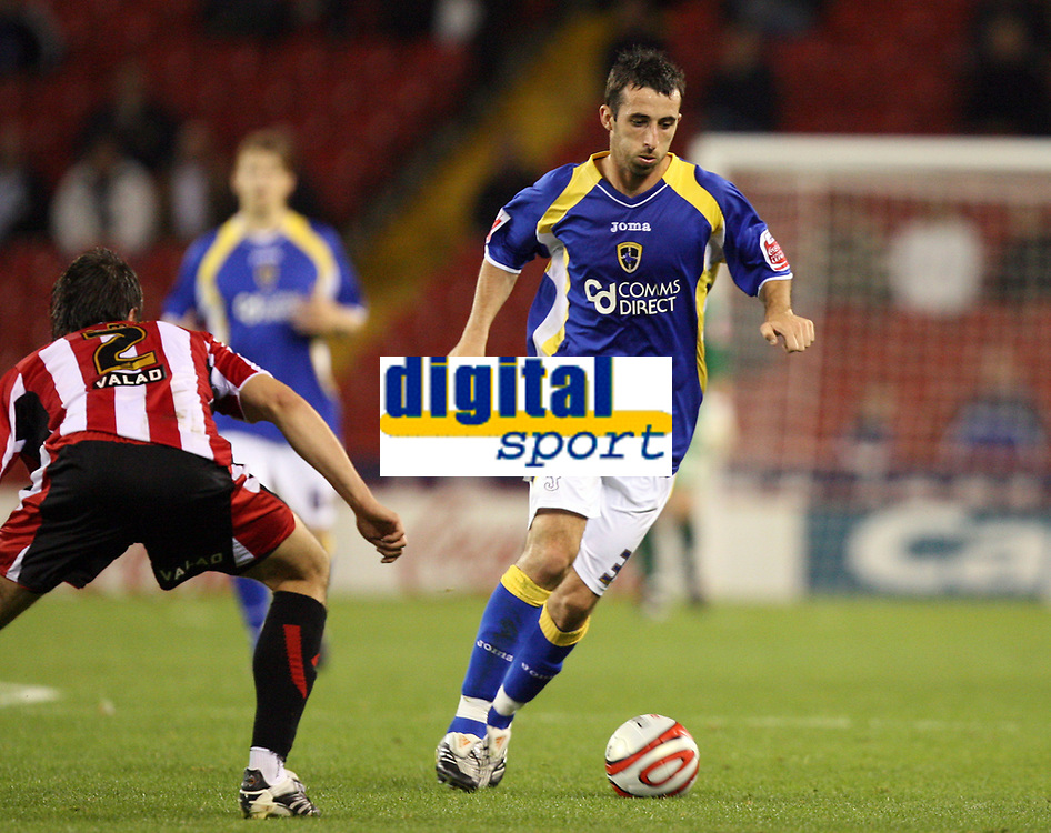 Photo: Paul Greenwood.<br />Sheffield United v Cardiff City. Coca Cola Championship. 02/10/2007.<br />Cardiff's Tony Capaldi (R) runs past a static Leigh Bromby,
