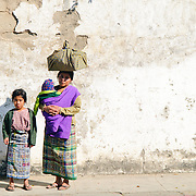 A Guatemalan woman poses with her daughter and baby on a street in Antigua, Guatemala.