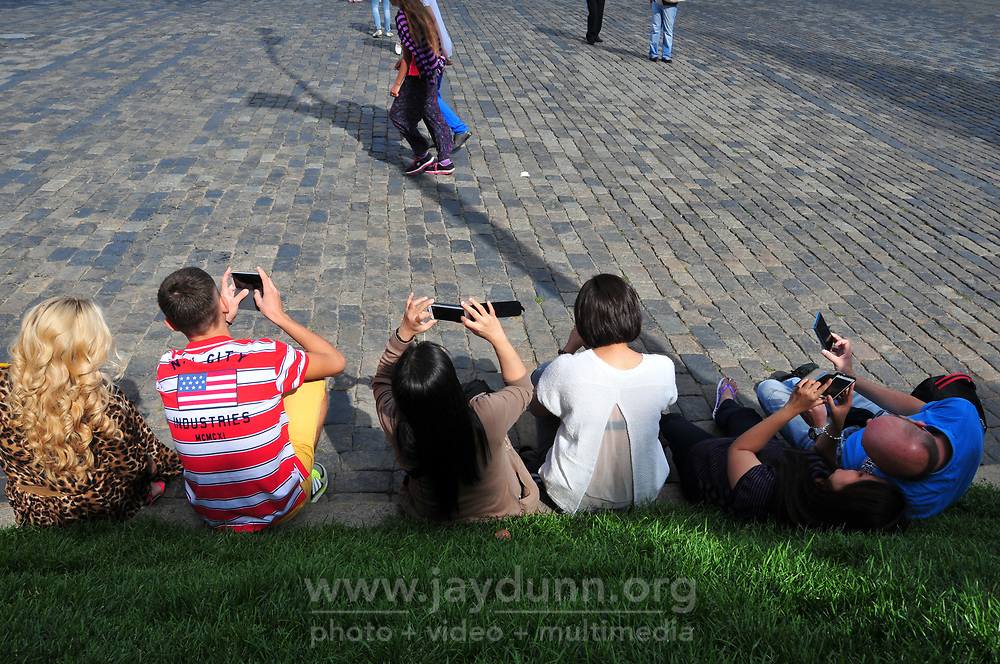 Visitors sit on the grass near St. Basil's Cathedral in Moscow. The structure, now a museum, was built in the mid-1500's and is a huge tourist draw. Part of the Kremlin and Red Square UNESCO World Heritage site, the cathedral is without a doubt the most recognizable Orthodox Christian church in the world.