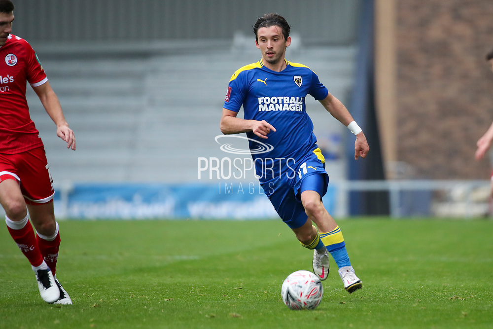 AFC Wimbledon midfielder Ethan Chislett (11) dribbling during the The FA Cup match between AFC Wimbledon and Crawley Town at Plough Lane, London, United Kingdom on 29 November 2020.