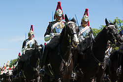 Windsor, UK. 9th June, 2021. The Household Cavalry Mounted Regiment proceeds along the Long Walk in Windsor Great Park following a dress rehearsal at Windsor Castle for Trooping the Colour. A socially distanced and scaled down Trooping the Colour ceremony to mark the Queen's birthday will take place at Windsor Castle on 12th June incorporating many of the elements from the annual ceremonial parade on Horse Guards, with F Company Scots Guards Trooping the Colour of the 2nd Battalion Scots Guards in the Castle Quadrangle.