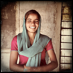"iPhone portrait of Keshanta Gujar, 16, in a village outside of Tonk, Rajasthan, India, April 3, 2013. ""To my colleagues and other girls I want to say that you too must study. I think that even kids can say no to their parents for marriage,"" said Gujar. <br />  <br /> Under Indian law, children younger than 18 cannot marry. Yet in a number of India's states, at least half of all girls are married before they turn 18, according to statistics gathered in 2012 by the United Nations Population Fund (UNFPA). However, young girls in the Indian state of Rajasthan—and even a few boys—are getting some help in combatting child marriage. In villages throughout Tonk, Jaipur and Banswara districts, the Center for Unfolding Learning Potential, or CULP, uses its Pehchan Project to reach out to girls, generally between the ages of 9 and 14, who either left school early or never went at all. The education and confidence-building CULP offers have empowered youngsters to refuse forced marriages in favor of continuing their studies, and the nongovernmental organization has provided them with resources and advocates in their fight."