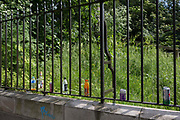 Discarded drink cans and bottles lined up on the railings bordering Brockwell Park during Field Day Festival on 1st June 2018, in the London borough of Lambeth, England.