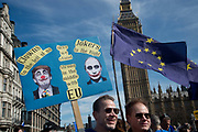 Hundreds of thousands of people protest in the Unite for Europe March on Parliament against Brexit demonstration on 25th March 2017 in London, United Kingdom. The march in the capital brings together protesters from all over the country, angry at the fact that Article 50 will be invoked and to listen to the 48 percent of British voters who voiced against Brexit. Since the vote was announced, there have been demonstrations, protests and endless political comment in all forms of media. Half of the country very displeased with the result and the prospect of being taken out of the European Union against their will, and with uncertainty as to what will happen next in the politics surrounding the exit from Europe. Two young men hold a EU flag and a placard quoting Bob Dylan with drawings of Trump and Putin.