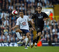 Photo: Chris Ratcliffe.<br /> Tottenham Hotspur v Portsmouth. The Barclays Premiership. 01/10/2006.<br /> Niko Kranjcar (R) of Portsmouth clashes with Jermaine Jenas of Spurs.