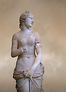 The Roman Venus Statue, the Goddess of Love, follows the style of a modest Aphrodite, known by other Roman replicas are copies of the third century BC Hellenistic Greek statues now lost. Dated circa 1st quarter of second century AD, the Venus statue was excavated from the Odeon of Carthage. The National Bardo Museum, Tunis. .<br /> <br /> If you prefer to buy from our ALAMY STOCK LIBRARY page at https://www.alamy.com/portfolio/paul-williams-funkystock/greco-roman-sculptures.html . Type -     BARDO    - into LOWER SEARCH WITHIN GALLERY box - Refine search by adding a subject, place, background colour, museum etc.<br /> <br /> Visit our CLASSICAL WORLD HISTORIC SITES PHOTO COLLECTIONS for more photos to download or buy as wall art prints https://funkystock.photoshelter.com/gallery-collection/The-Romans-Art-Artefacts-Antiquities-Historic-Sites-Pictures-Images/C0000r2uLJJo9_s0c