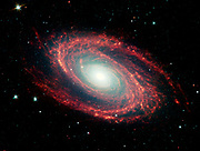 The spiral arms of the nearby galaxy Messier 81, located at a distance of 12 million light-years from Earth. Spitzer Space Telescope.