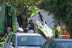 ©Licensed to London News Pictures 14/09/2020  <br /> Kidbrooke, UK. The cab of the lorry at the scene of the crash. A bin lorry has crashed into multiple cars and a house in Kidbrooke, South East London. A number of people have been injured police, fire and ambulance are all on scene. credit:Grant Falvey/LNP
