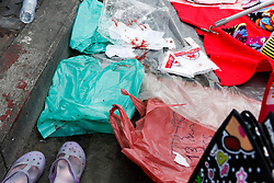 © Licensed to London News Pictures. 19/01/2014. Blood covers a stall used by a street side vendor after a grenade attack .The grenade attack has reportedly injured 28 people at the protest site at the Victory Monument in Bangkok Thailand. Anti-government protesters launch 'Bangkok Shutdown', blocking major intersections in the heart of the capital, as part of their bid to oust the government of Prime Minister Yingluck Shinawatra ahead of elections scheduled to take place on February 2. Photo credit : Asanka Brendon Ratnayake/LNP