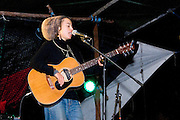 Saritah, Australian singer and musician performing at Upper Florentine summer gathering on on a stage that is built to block the forest access road made by contractors for Forestry Tasmania, in order to stop the logging of old growth forest in what is potentially a World Heritage Area...