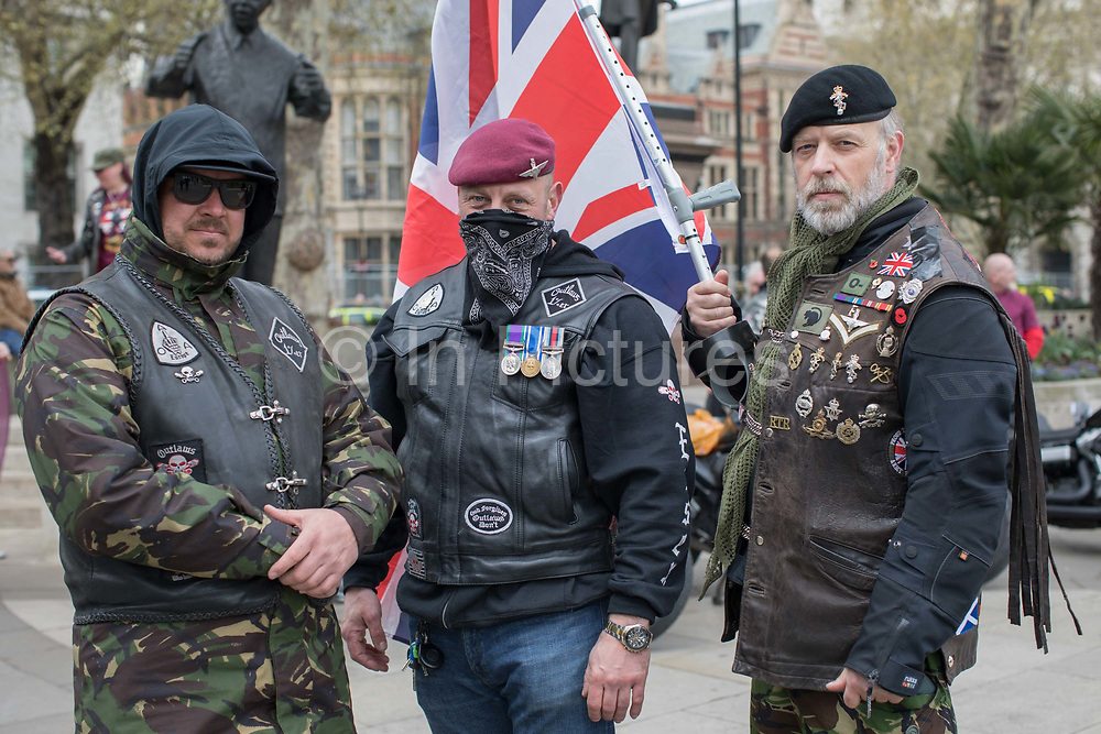 Motorcyclists gather outside Westminster protesting against the Bloody Sunday prosecution of Soldier F on April 12, 2019. A former British soldier faces murder charges of two people after troops opened fire on civil rights demonstrators on Bloody Sunday in Londonderry in 1972.