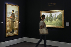 June 2, 2017 - London, UK - London, UK. A visitor walks by (L to R) ''Portrait of Yuri Repin by the Bay of Naples'', 1894, by Ilya Repin (Est. GBP 0.7-1m) and ''Summer'', 1891, by Isaak Levitan (est. 1-1.5m).  Preview of Sotheby's sale of Russian pictures and works of art which takes place on 6 June 2017 at Sotheby's in New Bond Street. (Credit Image: © Stephen Chung/London News Pictures via ZUMA Wire)