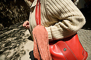 close up of woman with shoulder bag