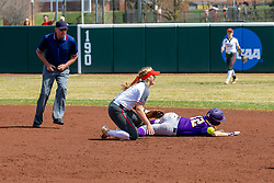 NORMAL, IL - April 06: Umpire Bryan Smith observes a play at 2nd with Emme Olson attempting to tag out Sammey Bunch during a college women's softball game between the ISU Redbirds and the University of Northern Iowa Panthers on April 06 2019 at Marian Kneer Field in Normal, IL. (Photo by Alan Look)