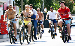 August 14, 2017 - Mugla, Turkey - August 14, 2017 - Bodrum, Turkey - Saudi Prince Talal bin Abdulaziz Al Saud and his relatives, friends an guards ride to bike in the Aegean resort of Bodrum early on Aug. 14. Prince and his family arrived in Bodrum early today.  The private jumbo jet carrying the prince and his family landed at the Milas-Bodrum Airport under tight security measures. The family got into six VIP cars and one bus waiting at the apron. They were escorted to the city center by two police vehicles and security guards. Around 300 luggage and 30 bicycles of the family were transferred to the truck only after hours. Their belongings were taken to a villa in the Göltürkbükü neighborhood. The Saudi prince and his family will reportedly stay in Bodrum for a week and will later embark on a blue voyage with a private yacht. (Credit Image: © Yasar Anter/Depo Photos via ZUMA Wire)
