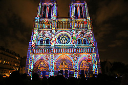 """Notre Dame cathedral is illuminated during a light show called """"DAME de COEUR"""" to celebrate the centenary of the first world war in Paris. France, novembre 10. 2017. Photo by Somer/ABACAPRESS.COM"""