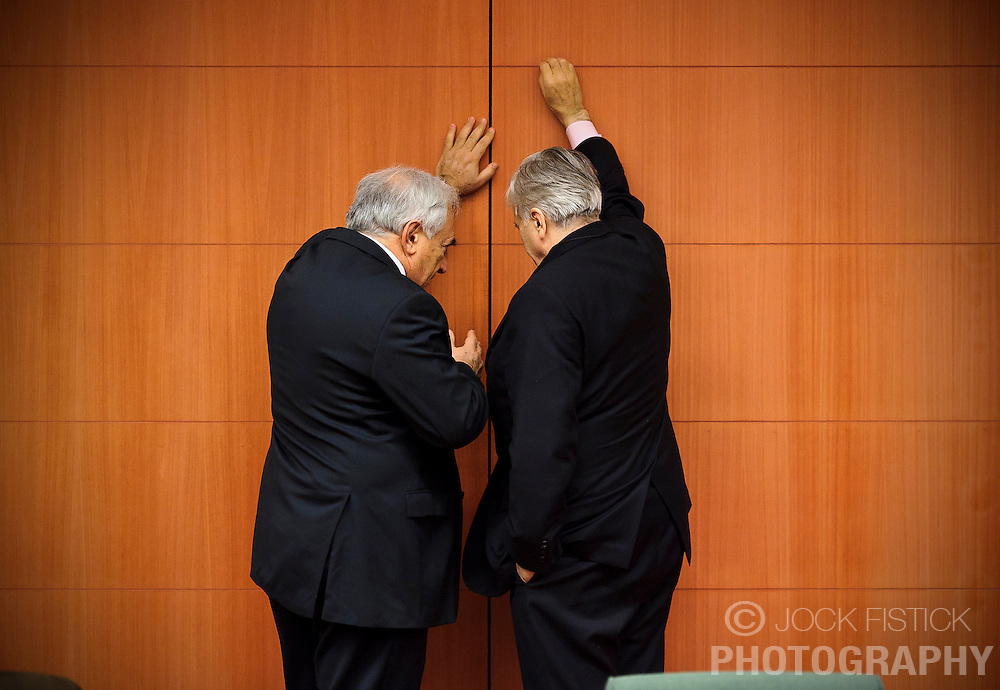 EURO CRISIS - Dominique Strauss-Kahn, managing director of the International Monetary Fund, left, speaks privately with Jean-Claude Trichet, president of the European Central Bank, as they try to construct financial bailout packages for Euro-zone countries on the brink of economic collapse, during a meeting of the Euro-zone finance ministers, at the EU Council headquarters in Brussels, Monday, Dec. 6, 2010.  (Photo © Jock Fistick)