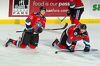 KELOWNA, BC - NOVEMBER 26: Dallon Wilton #15 and Devin Steffler #4 of the Kelowna Rockets stretch on the ice during warm up against the Edmonton Oil Kings at Prospera Place on November 26, 2019 in Kelowna, Canada. (Photo by Marissa Baecker/Shoot the Breeze)