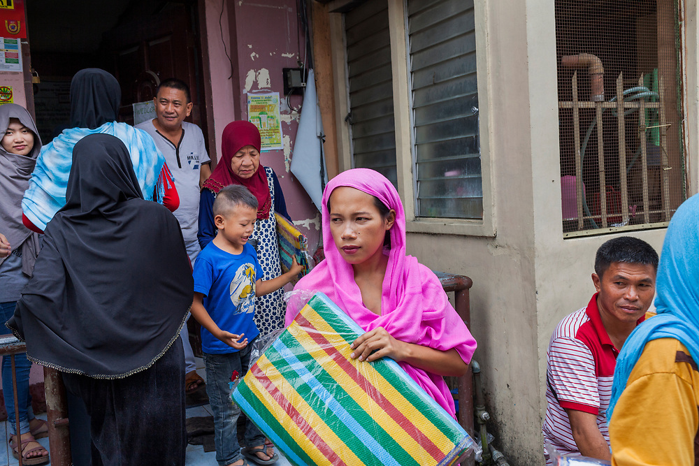 Davao City, Mindanao, Philippines - JUNE 22: An evacuee from Marawi collect supplies from the Mini Forest Barangay 23C Office.  Thousands of Marawi residents have escape the ongoing conflict after the ISIS backed Maute Group has sieged the city.  Currently, over 570 families and roughly 2500 evacuees from Marawi reside in the Mini Forest.