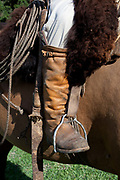 Detail shot of gaucho cowboy boots in a stirrup, on a horse. Working Gaucho Fazenda in Rio Grande do Sul, Brazil.