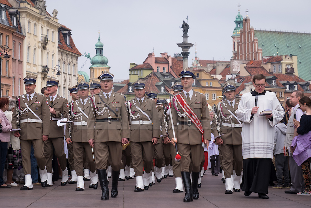 © Licensed to London News Pictures. 26/04/2016. Warsaw, Poland. A Polish military band taking part in a procession through Warsaw's Old Town in commemoration Corpus Christi (Boze Cialo). Corpus Christi (Body of Christ) is a Catholic feast celebrated as a national public holiday in Poland. It is the day when the Catholic Church commemorates the practice of Holy Eucharist, or Communion. Photo credit: Rob Arnold/LNP