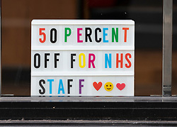 Edinburgh, Scotland, UK. 23 March 2020. Sign in restaurant window offering 50 percent reduction for NHS staff in Edinburgh. Iain Masterton/Alamy Live News.