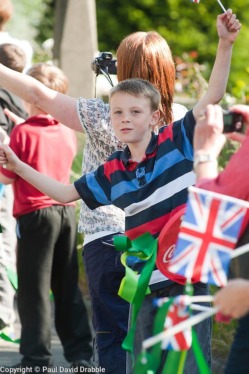 The Olympic Torch relay reaches Sheffield on day 38 coverage from the Chapeltown - Ecclesfield - Parson Cross section of the Journey. Crowds<br /> heading into Chapeltown.<br /> 25 June 2012.Image © Paul David Drabble