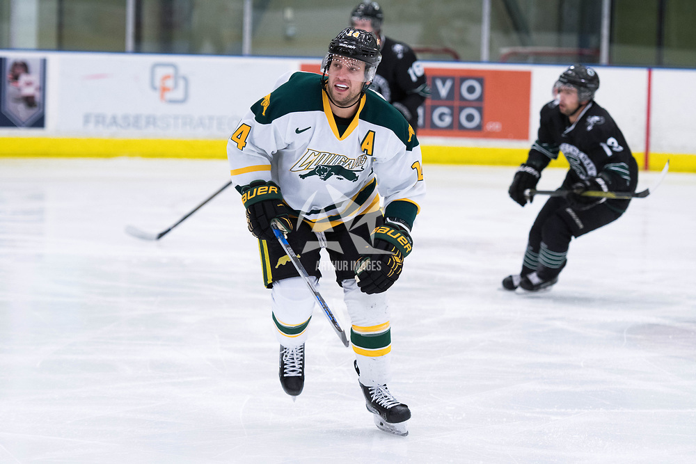 5th year forward Ian McNulty (14) of the Regina Cougars in action during the Men's Hockey Home Opener on October 6 at Co-operators arena. Credit: Arthur Ward/Arthur Images